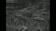 Scenes of Manhattan NYC before the civil defense drill street scene Herald Square with traffic pedestrians Macy's Department Store / street sign 'W...