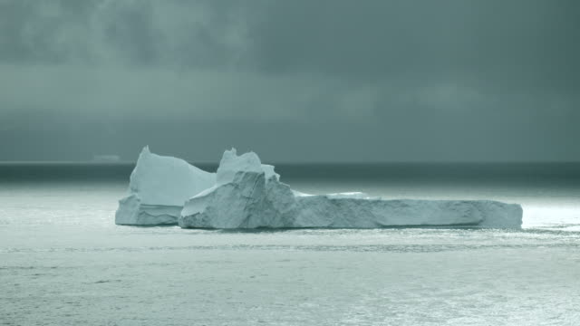 Scenic View Of Massive Iceberg Near Greenland