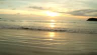 Scenic view of sunrise over ocean and beach