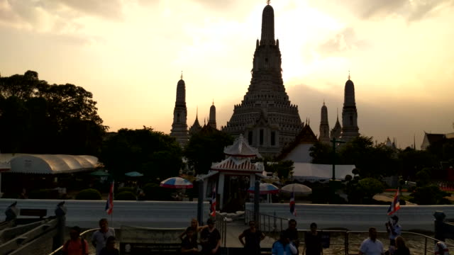 Scenic view of the famous silhouette of the Buddhist temple Wat Arun from the Chao Phraya River in Bangkok, Thailand