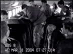 / School bus camera surveillance video kids on bus one large kid walks over to boy sitting in a seat and starts punching him out of nowhere other...