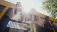 School Bus Windows Student Waving 4K 4:2:2 Slow motion