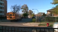 WGN School Buses Drive Away From A McKay School in Chicago on November 9 2015
