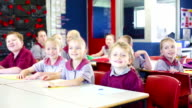 School Children Answering Questions in the Classroom