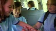 CU, TU, TD, R/F, school children (8-11) playing cats cradle sitting in van, Bovina, New York State, USA