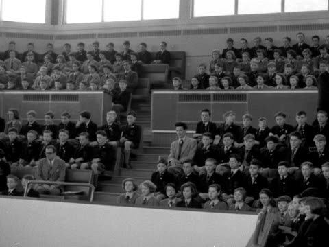 School children sit in a hall for assembly at Woodberry Down Comprehensive school