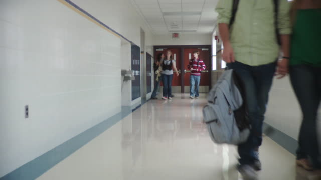 WS DS School children (12-17) walking down corridor, Cazenovia, New York, USA