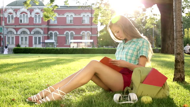 School girl reading a textbook