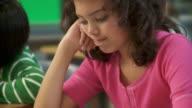 CU, TU, School girl (10-11) thinking sitting over test in classroom, Richmond, Virginia, USA