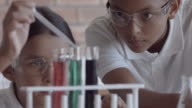 CU School girls in science class with beacons and test tubes