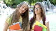 School girls posing and looking at camera