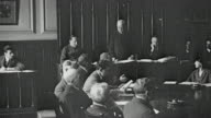1925 HA School governors assembled at round table meeting and voting on a resolution by raised hands / Newcastle upon Tyne, England, United Kingdom