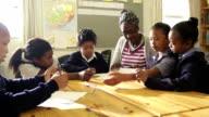 School Kids show teacher their drawings