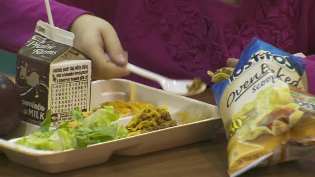 WXMI School Lunches Being Eaten at an Elementary School Cafeteria in Grand Rapid Michigan on September 15 2015