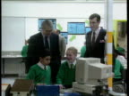 School performance tables LIB Harris City Technology College Schoolboy in uniform using soldering iron Then PM John Major MP visiting classroom with...