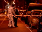 Schoolboy stabbed in West London ENGLAND London Hammersmith Forensic officers behind police cordon at crime scene