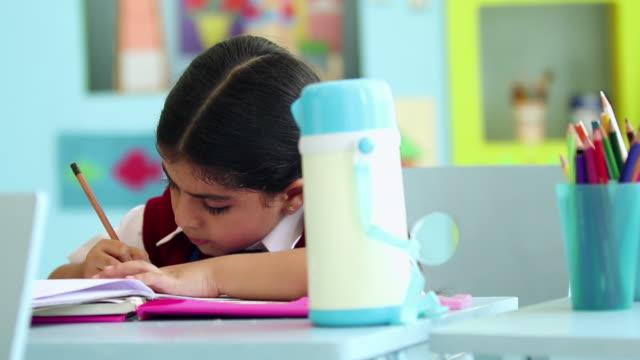 Schoolgirl studying in the classroom, Delhi, India