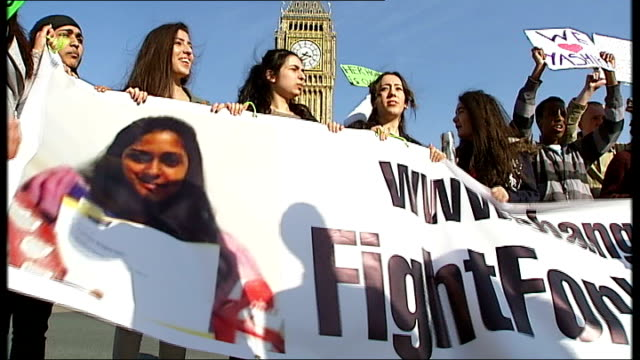 Schoolgirl Yashika Bageerathi deported to Mauritius T29031421 / TX EXT Students protesting outside Parliament and holding banner 'Fight For Yashika'...