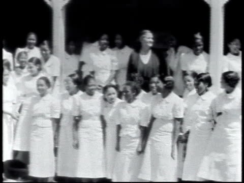 1940 PAN schoolgirls in white dresses posing for graduation pictures / Alabama, United States