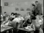 Schoolhouse bicycles INT Woman Dr Barnard Joy observing elementary children in class MS Woman joy drawings on wall BG MS Children at desks VS CU...