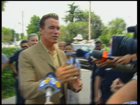 Schwarzenegger up to press while campaigning Arnold Schwarzenegger press conference SOT my campaign is positive campaign