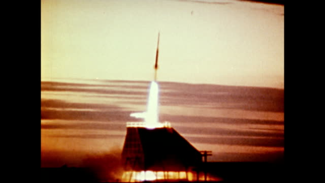 / scientific sounding rocket is launched into atmosphere / technicians watching launch Scientfic Sounding Rocket launched on January 01 1971
