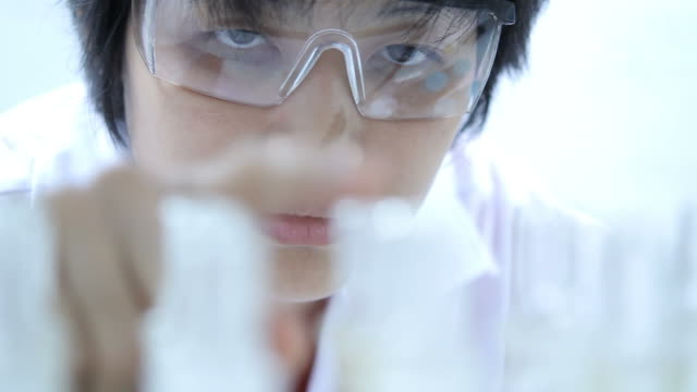 Scientist checking chemical containers