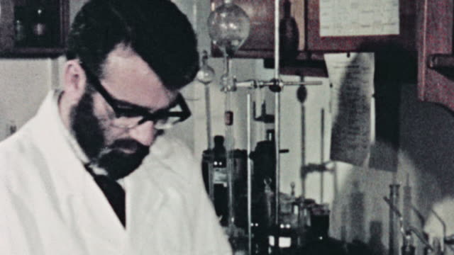 MONTAGE Scientist in a lab studying effects of tar from cigarette smoking / United Kingdom