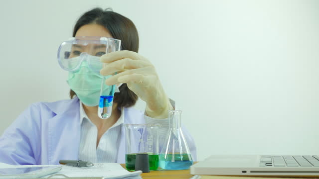 Scientist mixing substance. Front view. From right to left.