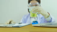 Scientist notice the substance. Front view. Zoom in.