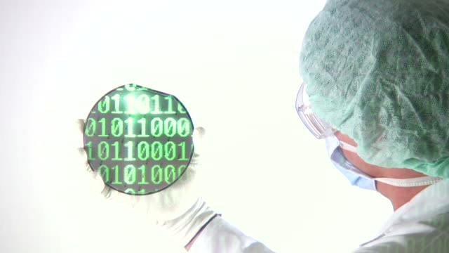 Scientist reviewing Computer Chip Wafer binary code