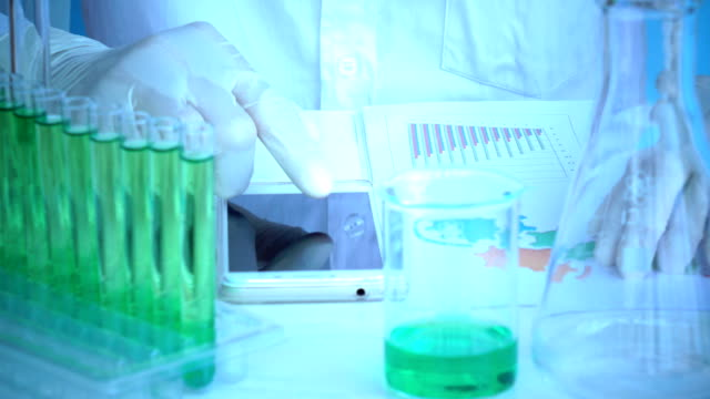 scientist using smart phone in laboratory