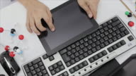 Scientists hands using digital tablet in laboratory.