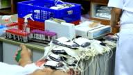 Scientists loading sample vials into centrifuge.