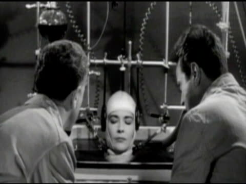 MS Scientists looking  at  woman's head  / United States