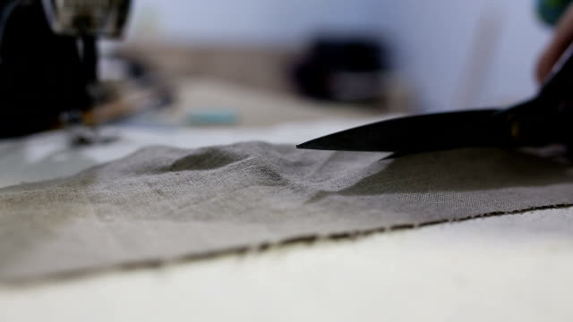 Scissors cutting cloth