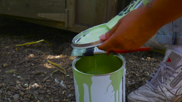Scooping Paint on Lid at Farm