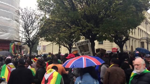 Scores of people sang and danced in the rain outside Zimbabwe House on The Strand in central London as they celebrated what they termed 'our...
