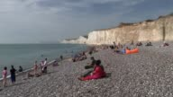 Scores treated for chemical 'mist' in East Sussex East Sussex Birling Gap beach EXT Various of holidaymakers and sunbathers on beach/ Vox pop/ Long...