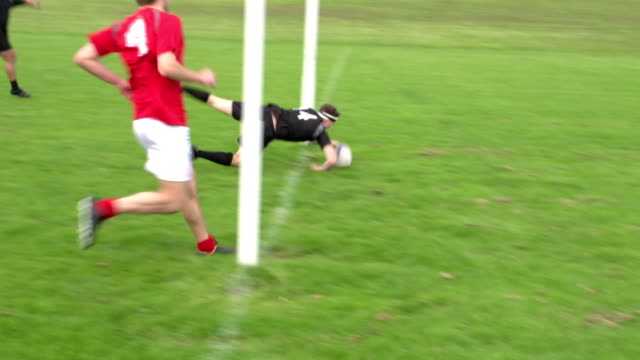 Scoring a try in Rugby match under the posts (Sport)