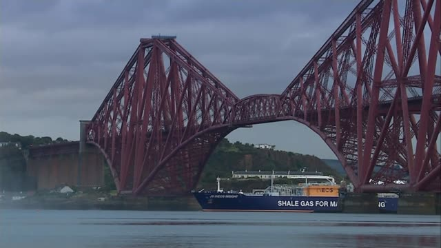 Scotland ban fracking DATES EXT Various of gas refinery buildings and chimneys Boat 'Shale Gas For Manufacture' under Forth bridge ENDS Tom Pickering...