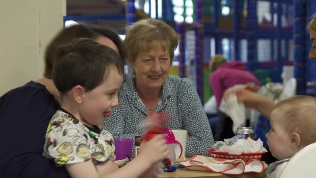 Scotland set to ban parents smacking children in first for UK SCOTLAND Glasgow INT Children sliding down slide inside children's play centre Man...