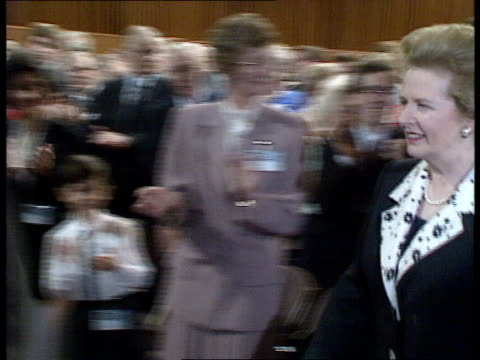 Tory Party Conference Prime Minister Thatcher speech SCOTLAND Aberdeen MrsThatcher walking down isle in conf centre behind piper Thatcher supporters...