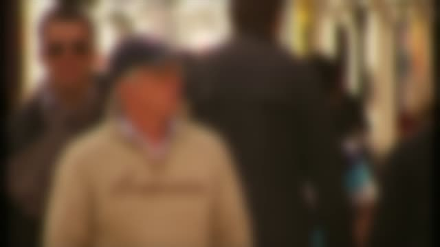 Scotland Yard investigates Spacey allegations London EXT Blurred shot people along in street