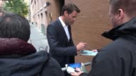 Scott Foley poses with fans while departing from The View set on October 20 2014 in New York City