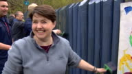 Scottish Conservative MP Ruth Davidson painting a fence