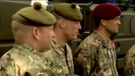 Cameron visits Maryhill Barracks SCOTLAND Glasgow Maryhill Barracks INT David Cameron MP sat talking to soldiers Cameron along and talking to...