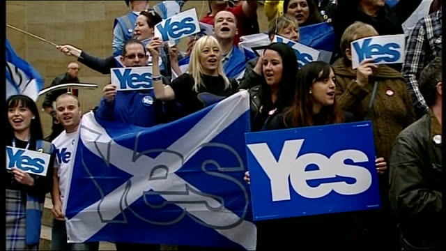 Final day of campaigning Royal Concert Hall EXT 'Yes' campaigners with balloons and 'Let's do this' placards standing on steps and chanting SOT 'Yes'...