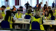 Postal ballots checked SCOTLAND Edinburgh INT Various of people sat at tables checking and verifying postal ballots for the Scottish Independence...