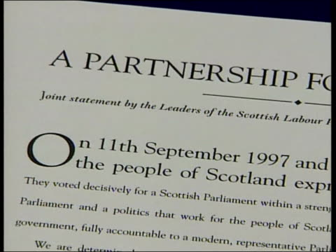 Lib Dem/Labour Coalition SCOTLAND Edinburgh Donald Dewar MSP Jim Wallace MSP signing documents formalising coalition deal between Labour the Liberal...